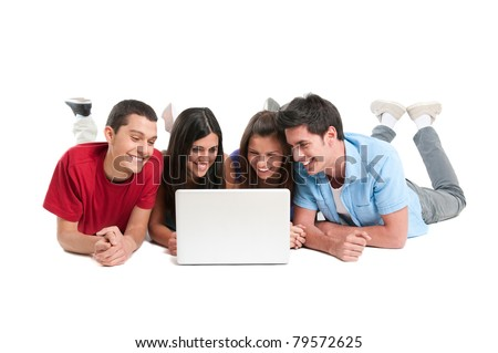 Happy smiling young group of friends watching and working together at laptop isolated on white background - stock photo