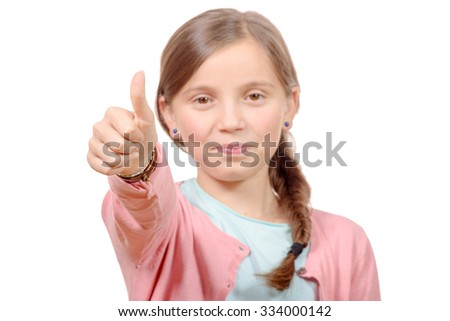 happy, smiling young little girl giving thumb up gesture, isolated on white - stock photo