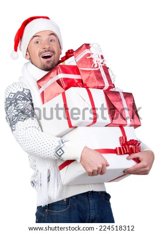 Happy smiling young man in Santa Claus hat with gift box, isolated on white background - stock photo