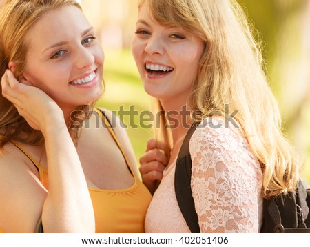 Happy smiling young women outdoor. Pretty attractive girls portrait.