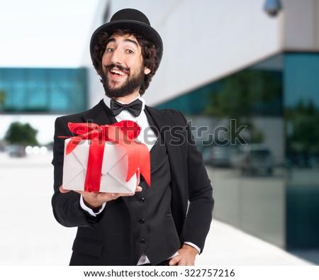 happy smoking man with gift - stock photo