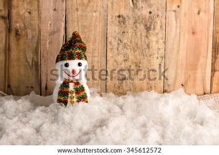 happy snow ball  on snow and wooden background - stock photo
