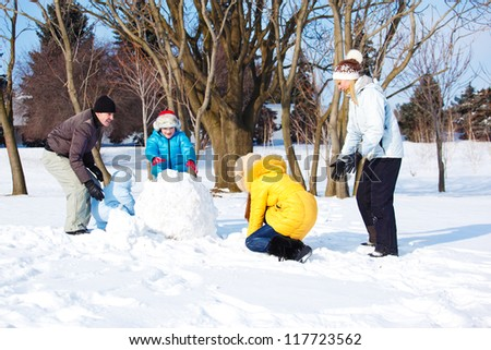 Happy snow leisure in winter park - stock photo