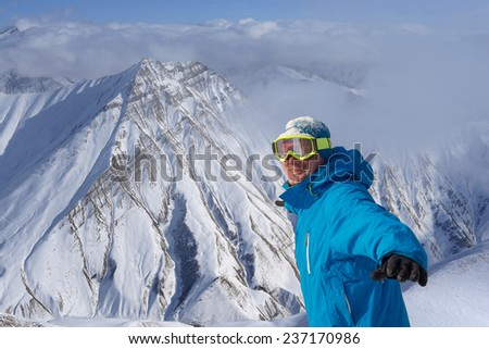 Happy snowboarder on the precipice - stock photo