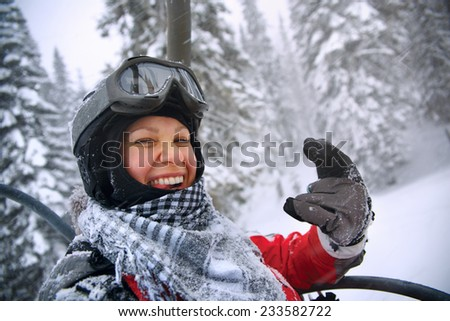 Happy snowboarding girls in winter mountains - stock photo