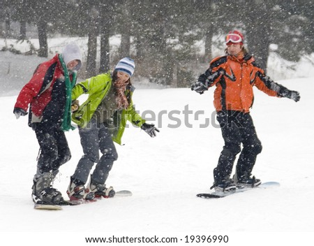 Happy snowboarding team in winter mountains, health lifestyle - stock photo