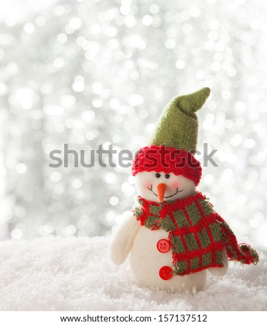 happy snowman with lights in the background. - stock photo