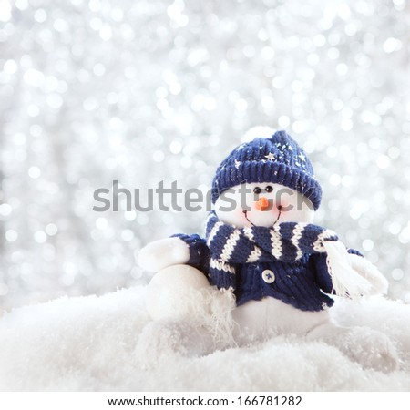 happy snowman with snowball.  - stock photo