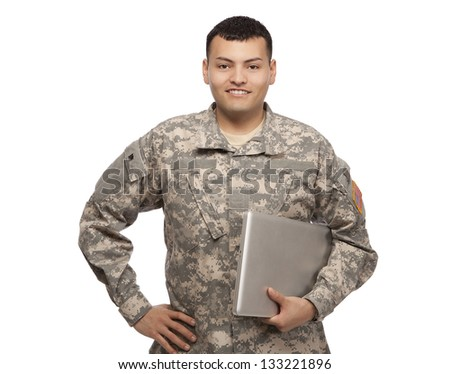 Happy soldier holding a laptop and standing with hand on hips - stock photo
