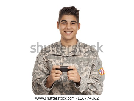 Happy Soldier texting on cell phone - stock photo