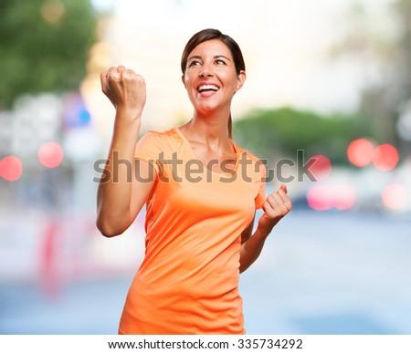 happy sport woman celebrating sign - stock photo