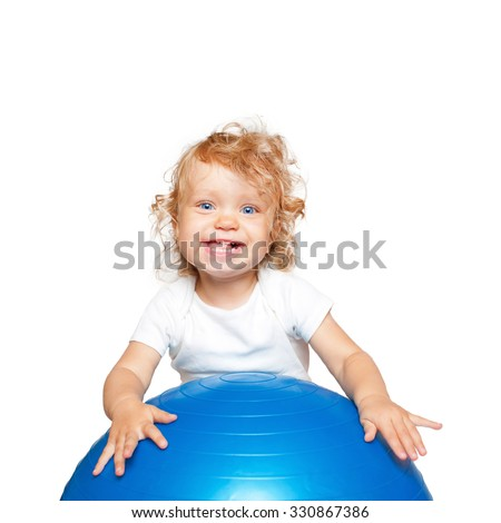 Happy sportive baby playing with fitness ball. Isolated on white background
