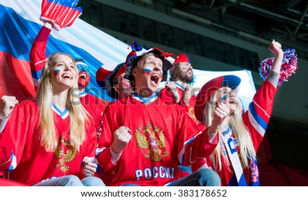 Happy sports fans in stadium - stock photo