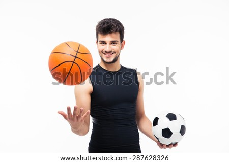 Happy sports man holding basketball and soccer ball isolated on a white background
