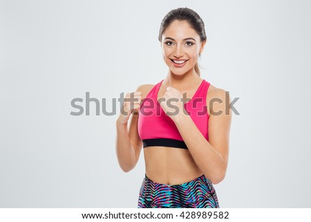 Happy sports woman posing isolated on a white background - stock photo
