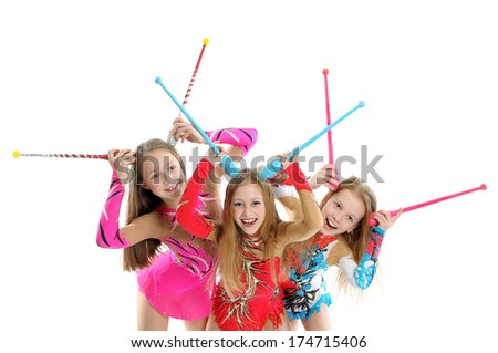 Happy sporty children with gymnastic clubs - stock photo