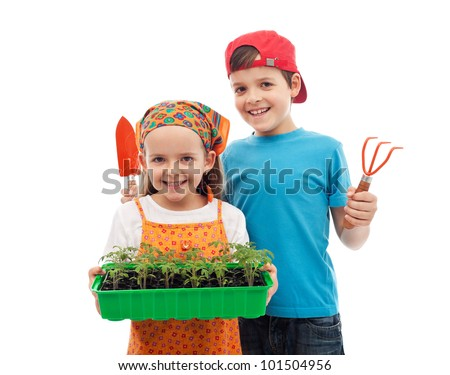 Happy spring gardening kids with seedlings and tools - isolated