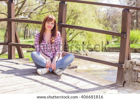 Happy spring young woman , caucasian female relaxing in the park. - stock photo