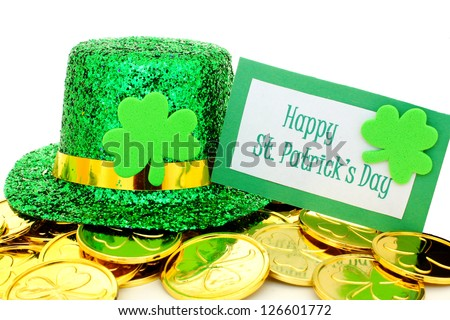 Happy St Patrick's Day tag with party hat and gold coins over white - stock photo