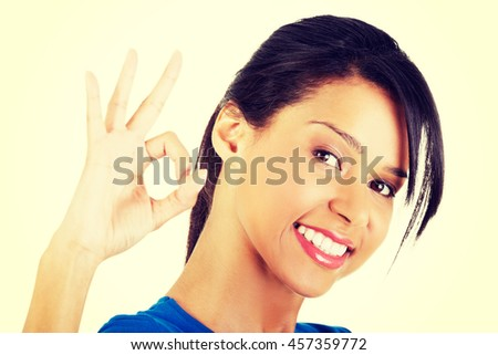 Happy student girl gesturing perfect