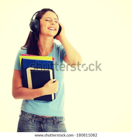 Happy student girl listening to the music - stock photo