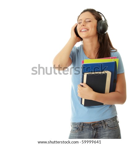 Happy student girl listening to the music, isolated on white - stock photo