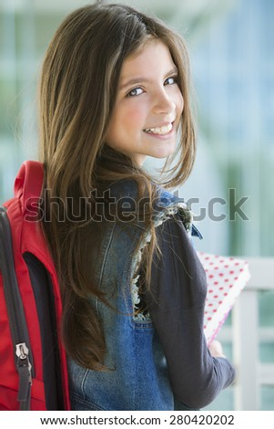 Happy student girl with backpack and books, back to school - stock photo