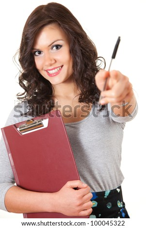 happy student girl with clipboard and pen pointing you, white background