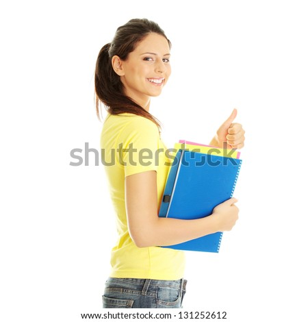 Happy student girl with thumb up, isolated on white - stock photo