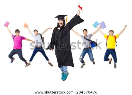 Happy  student group in graduate robe jumping together - stock photo