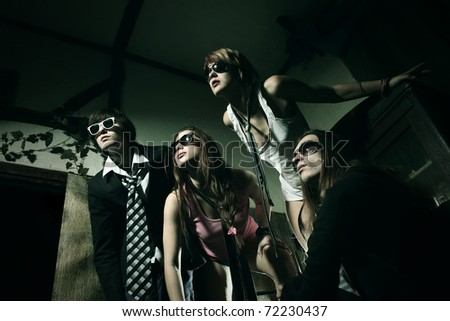 Happy student group of friends in party - stock photo