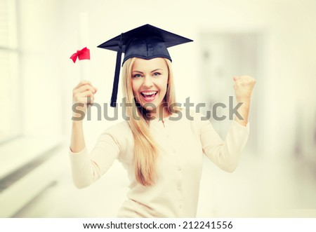 happy student in graduation cap with certificate - stock photo