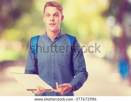 happy student man with a notebook - stock photo