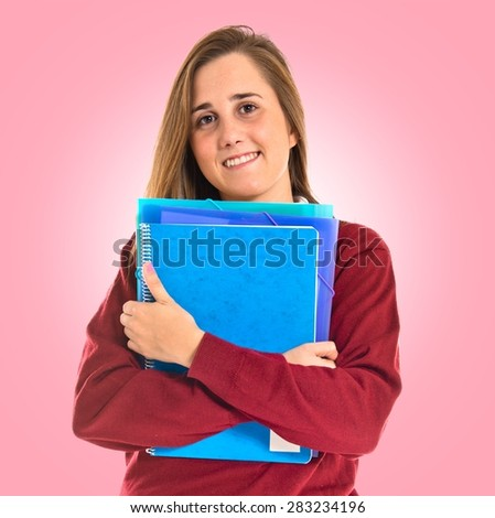 Happy student over colorful background - stock photo