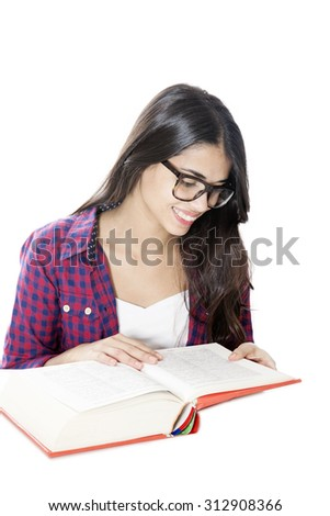 Happy student reading with glasses