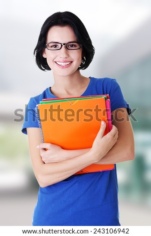 Happy student woman with notebooks. - stock photo