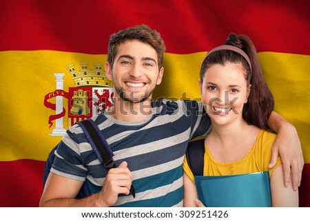 Happy students against digitally generated spanish national flag