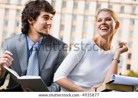 Happy students are studing lectures near university - stock photo