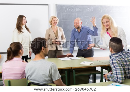 happy  students chatting at training session for employees during break in classroom   - stock photo