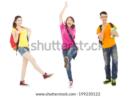 happy students listening music and jumping  - stock photo