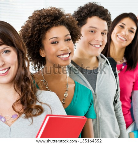 Happy Students Standing In Row And Looking At Camera Smiling - stock photo