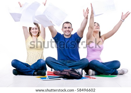 happy students throwing books away â?? end of school - stock photo