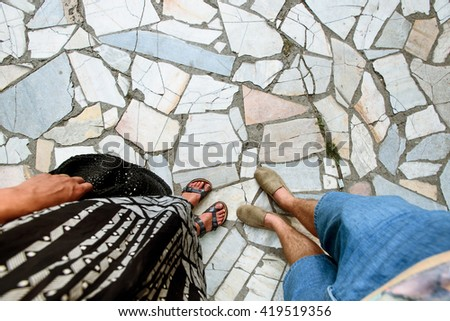 happy stylish couple legs at the amazing tile, summer travel together concept, space for text - stock photo