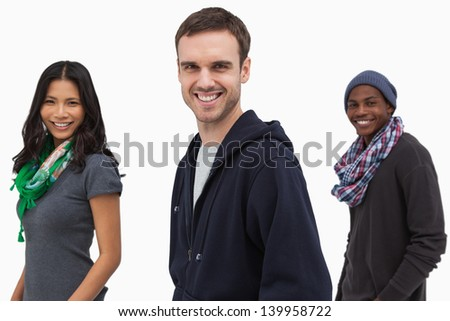 Happy stylish young people in a line on white background - stock photo
