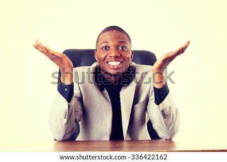 Happy successful businesman at the desk - stock photo