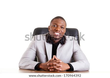 Happy successful businesman at the desk. Isolated on white. - stock photo