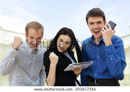 Happy successful business people raised arms � showing success concept - stock photo