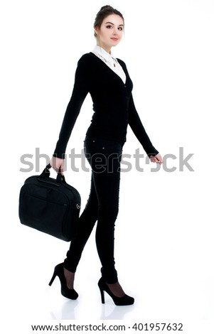 Happy successful business woman in black suit with bag - stock photo