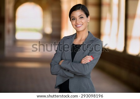 Happy successful smiling business woman executive female in a suit  - stock photo