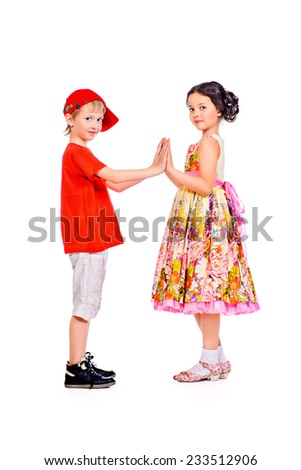 Happy summer children in bright clothes standing together holding hands. Full length portrait. Isolated over white. - stock photo